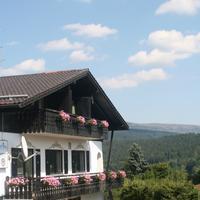 Gästehaus am Berg Guesthouse exterior with view towards Sumava national Park