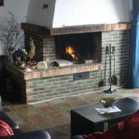 Gästehaus am Berg Guest lounge fireplace