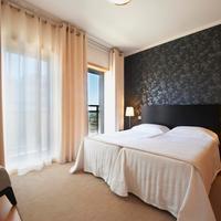 Real Marina Residence Guestroom
