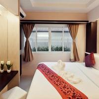 Excella Hotel Guestroom